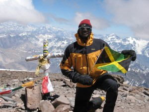 Rohan Freeman atop one of the Seven Summits representing Jamaica, his native country.